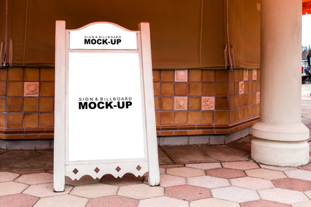 The mock up blank white display of large wooden pink poster stand on walkway for show promotion or information, beautiful standy design with clipping path