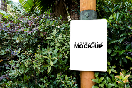 Stock Photo   The Mock Up Blank White Screen Banner On The Wooden Pole At  Garden For Information Or Advertisement On Display With Clipping Path