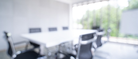 Blurred image of meeting room in the modern office - ideal for presentation background.