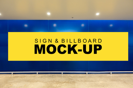 Mock up front view a large horizontal advertising billboard with clipping path on blue wall background in building, blank yellow screen empty space for in formation, advertisement