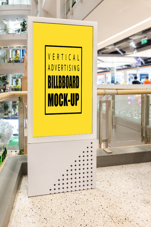 Mock-up vertical blank yellow screen indoors advertisement signboard stand with clipping path in superstore