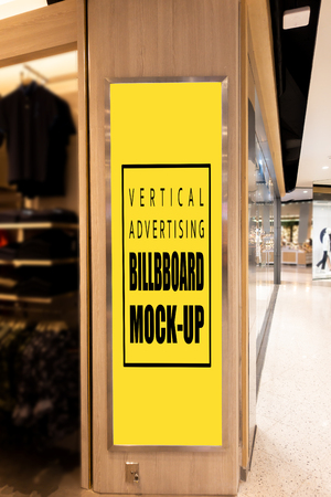 Mock up vertical advertising blank yellow screen billboard with clipping path for insert text message or media content at front of entrance shop, marketing and advertisement concept Banco de Imagens
