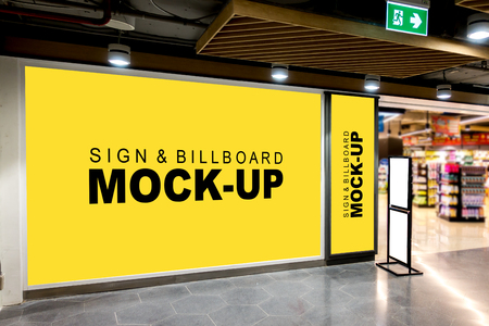Mock up large blank yellow screen billboard and vertical signboard and white screen on stand board with clipping path in mall and blurred shelf in background, empty space for advertising information