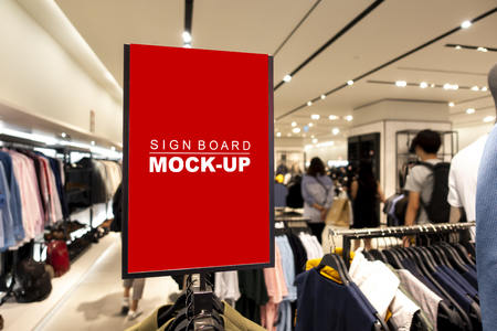 Mock up vertical blank banner or signboard on hanger   to show promotion or discount in shop clothing, red screen empty space for insert text or advertising in shopping mall
