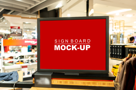 Mock up horizontal blank signboard in black frame   to show promotion or price at fashion clothes shop, Red screen empty space for insert text or advertising Banco de Imagens