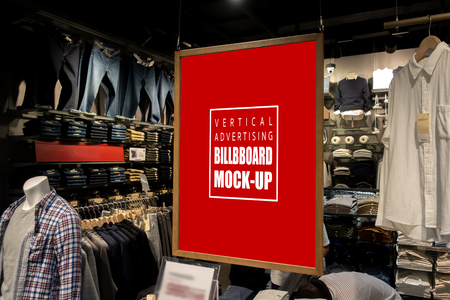 Mock up vertical blank billboard hanging  to show promotion at fashion clothes shop for men, Red screen in wooden frame from ceiling, empty space for insert text or advertising Banco de Imagens