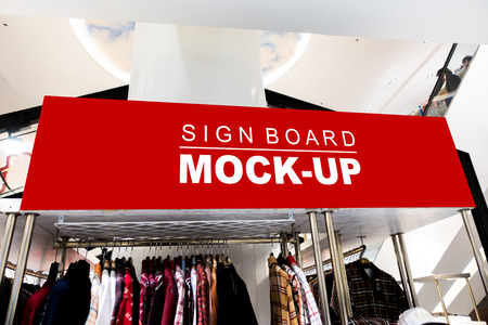 Mock up large horizontal blank banner or signboard with clipping path to show promotion or discount in shop clothing, red screen empty space for insert text or advertising in shopping mall