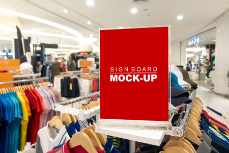 Mock up horizontal blank signboard in acrylic frame   to show promotion or price at fashion clothes shop, Red screen empty space for insert text or advertising
