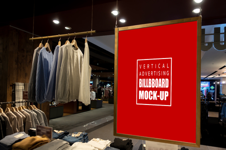 Mock up vertical blank billboard hanging to show promotion at fashion clothes shop for men, Red screen in wooden frame from ceiling, empty space for insert text or advertising