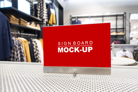 Mock up perspective blank billboard  to show promotion or discount in accessory and clothing shop, yellow screen empty space for insert text or advertising in shopping mall Banco de Imagens