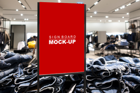 Mock up vertical blank banner or signboard in frame   to show promotion or discount in shop jeans clothing, yellow screen empty space for insert text or advertising in shopping mall