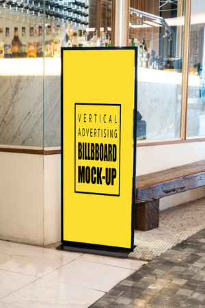 Mock up vertical blank billboard standing  at front of modern restaurant, Yellow screen empty space for insert text or advertising