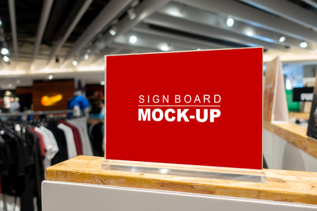 Mock up horizontal blank signboard  to show promotion or price at fashion clothes shop, Red screen in acrylic frame, empty space for insert text or advertising Banco de Imagens
