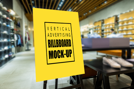 Mock up perspective of vertical advertising billboard   on wooden stand in showroom of sport shoe, yellow screen empty space for insert text and price