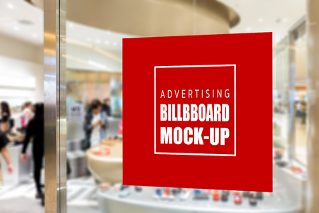 Mock up blank signboard advertising on glass wall near entrance of shoe shop, red screen empty space for insert text and price