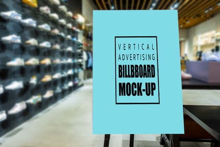 Mock up perspective of vertical advertising billboard  on wooden stand in showroom of sport shoe, blue screen empty space for insert text and price