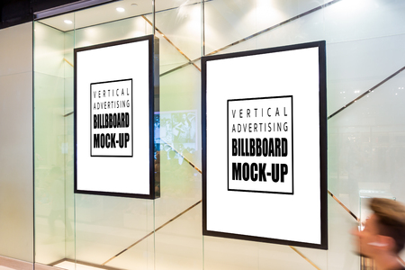 Mock up perspective blank billboard  , advertising with poster in glass frame hanging, display decoration at front of showroom, empty space for insert text or media