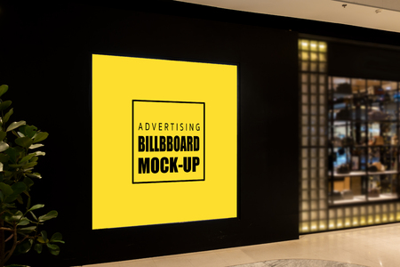 Mock up blank billboard , Advertising signage for promotion on black wall at aisle inside the department store, yellow screen empty space for insert text or media Banco de Imagens