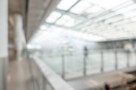 Blurred background image with beautiful architecture of modern airport, nobody at empty area.