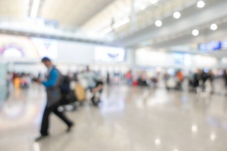 Blurred backgrund image with movement of the traveller walking with luggage in airport hall