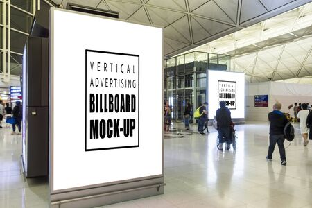 Mock up two perspective blank vertical billboard advertising with standing in airport terminal hall, passengers walking around area, empty space for advertisement or information Stockfoto - 140408752
