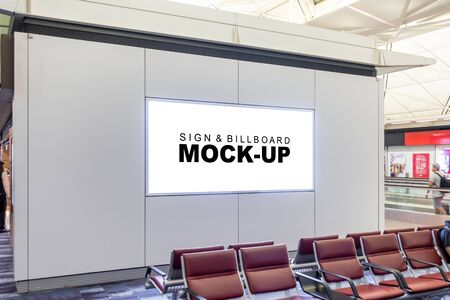Mock up blank horizontal signboard advertising with on panel over seat for waiting in hall of airport, empty space for insert announcement or advertising information