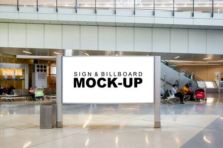Mock up large blank billboard with on metal frame standing on walkway in hall of airport area, empty space for advertising or information, advertising concept Stockfoto - 140408822