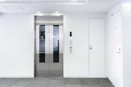 The Elevator in the modern building, closed door stand by near exit door, stand by on first floor, image for background or insert advertising graphic design Archivio Fotografico