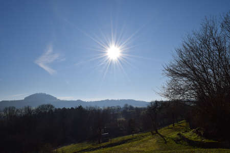 Sun looks like a shining star in winter at the Wäscherschloss in Wäschenbeuren, Germany