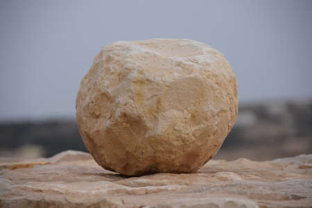 Cannonballs made of stone on the wall of the old crusader castle Shobak in Jordan Stock Photo