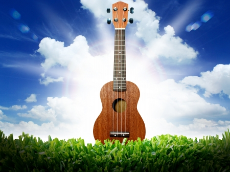 Ukulele with blue sky   photo