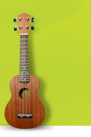 Ukulele on green wall background  photo