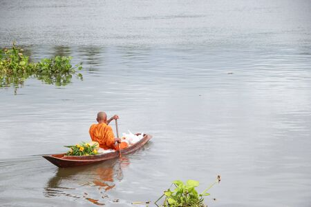 The monks were ferried to beg for food In the morning by boat