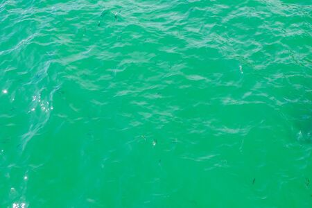 The image of the sea is bright green and blue. Stock Photo