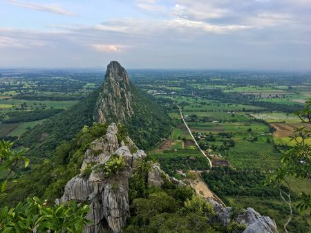Khao Nor - Khao Kaew, limestone mountains, beautiful viewpoint, Nakhon Sawan province Can be clearly seen from Phahonyothin Road Nakhon Sawan - Kamphaeng Phet Section is located in Ban Dan Subdistrict, Banphot Phisai District Nakhon Sawan province.