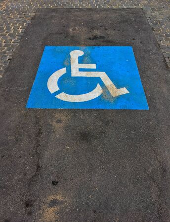 floor of the road with signs for disabled people.