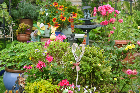 Colorful garden in summer with garden decorations