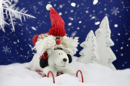 Santa claus and polar bear sledding in a snowy winter landscape