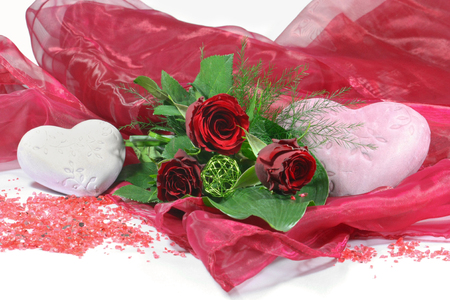 bouquet of red roses and heart decorations isolated on white background
