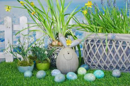 funny easter bunny in easter eggs and flower decorations