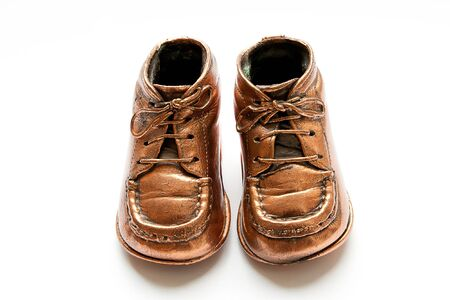 copper coated: pair of baby shoes in bronze