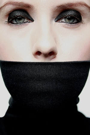 covered: Young woman with covered mouth