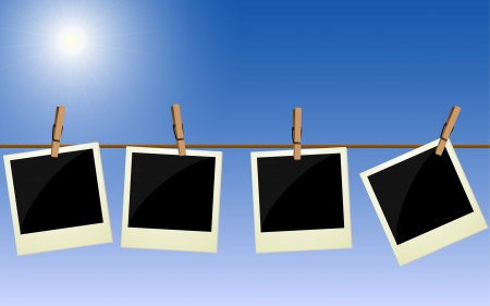 drying: Four   pictures hanging on rope against bright sky
