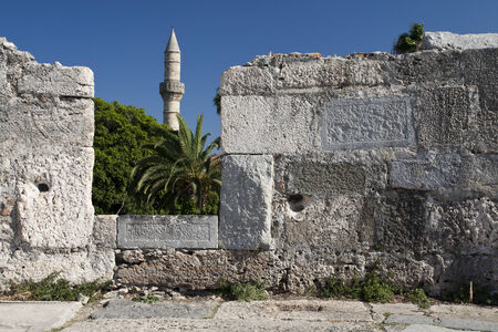 Minaret tower and castle wall in Kos city; Greece