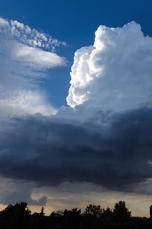 extreme weather: clouds with blue sky in location by a extreme, stormy weather in germany