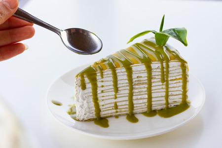 cake plate: green tea  crape cake on white background Stock Photo