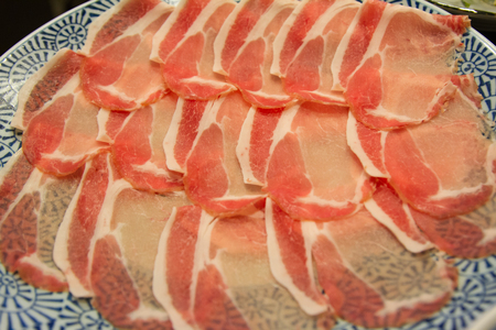 limp: Slide raw pork on the table. Close up Stock Photo