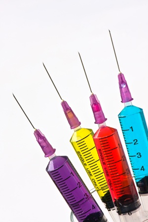 Syringes filled with solution various bright colors photo