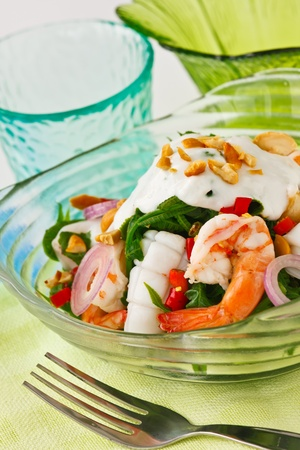 Thai fusion food, Fern and seafood salad with sour and spicy coconut milk dressing. photo