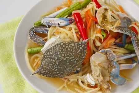 Thai popular dishes, spicy papaya salad with raw blue crab photo